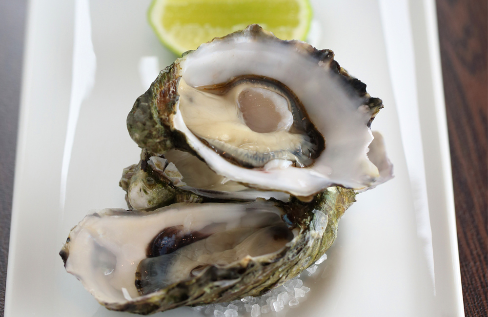 South Australian West Coast oysters served au naturel with a drizzle of ten year old Laphroaig whiskey