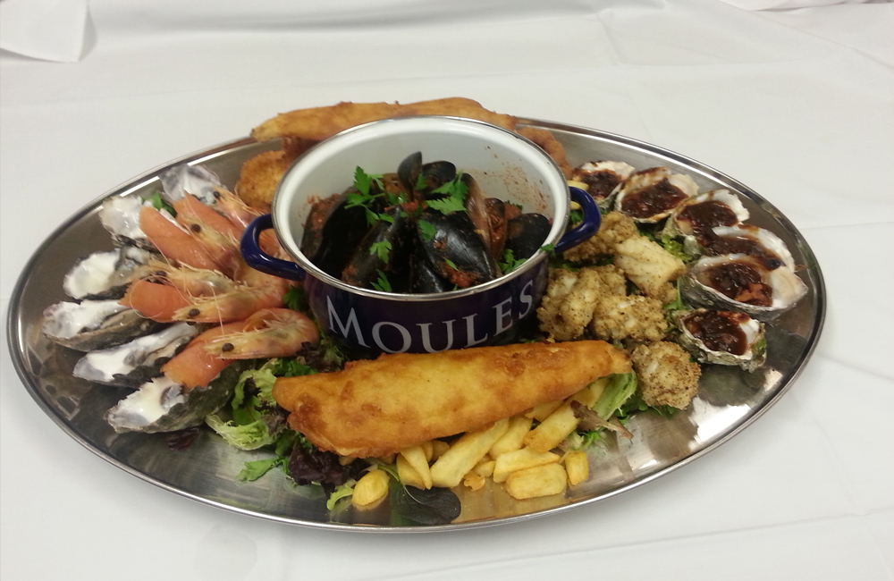 Seafood Catch platter includes battered garfish, panko whiting, crumbed scallops, lemon pepper squid, king prawns, and oysters
