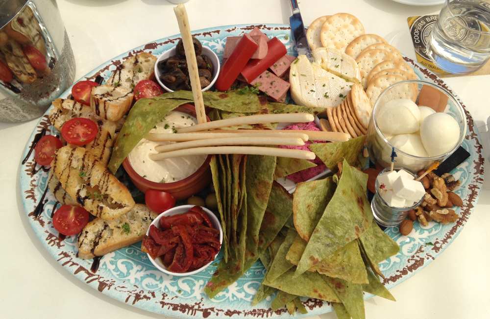 The Deck Eat Local SA platter bursting with South Australian cheese-making skill, including Udder Delights and Divine Dairy.