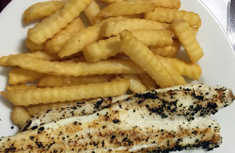 Port Wakefield Hotel King George whiting and garfish, snuggled up in a robe of your choice of seasoned crumbs or crispy batter, and accompanied by crunchy chips.